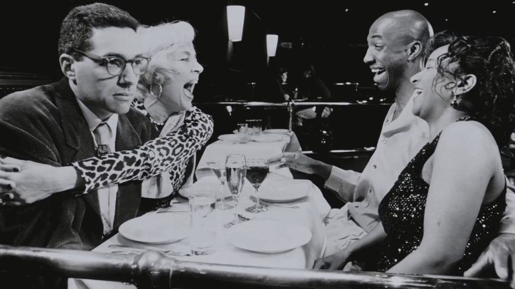 Left to right: Charles, Lola (Heather Morgan), Mel (J.B. Smoove), and Wanda (Wanda Sykes). This scene sums up the personality of the film quite well.