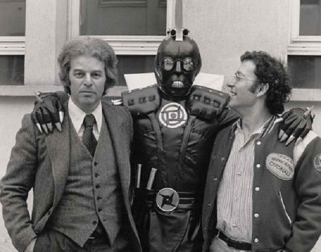 Jodorowsky and Moebius pose with an actor in costume.