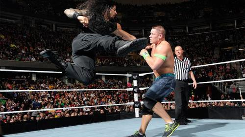 Roman Reigns Superman punches Superman stand-in John Cena.