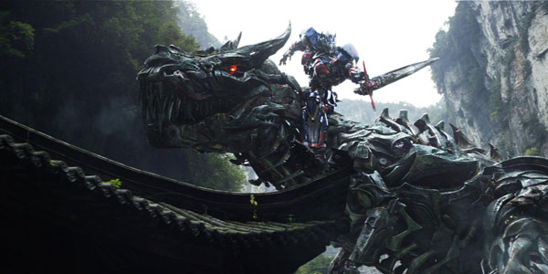 Optimus Prime riding a giant, robot dinosaur. (Source)