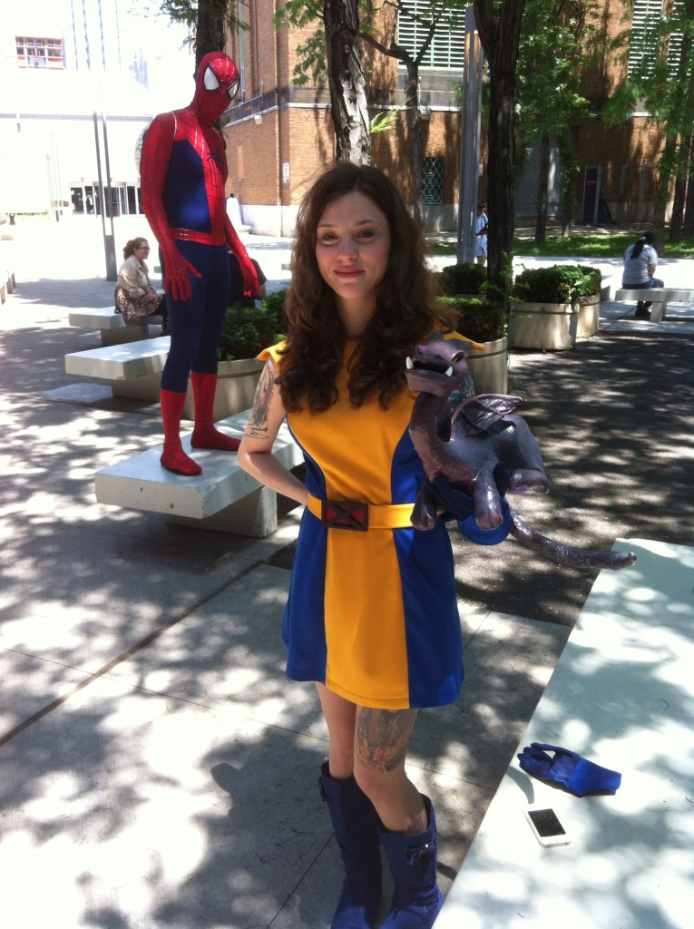 Spider-Man, Kitty Pryde, and Lockheed in front of the Javits Center. (Civilian IDs unknown.)