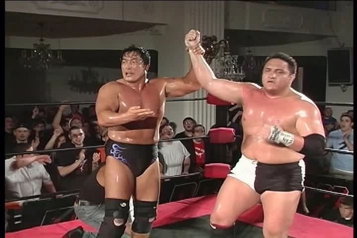 Kenta Kobashi raises Samoa Joe's hand after literally beating the shit out of him. (Source)