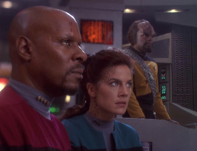 Captain Benjamin Sisko (Avery Brooks), and Lieutenants Dax (Terry Farrell) and Worf (Michael Dorn) in the action-packed Season Four relaunch.