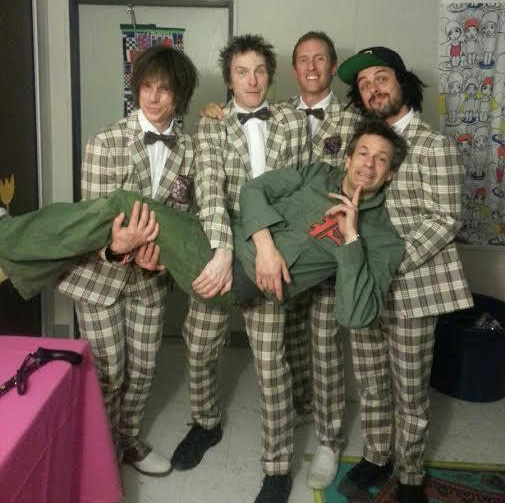 The Replacements doing a little labor carrying their frontman
