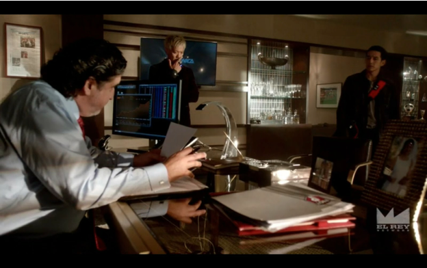 A villain, no doubt doing shady things in his shady office.