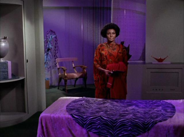 Uhura, off the clock in her quarters, surrounded by pieces of her home on Earth.