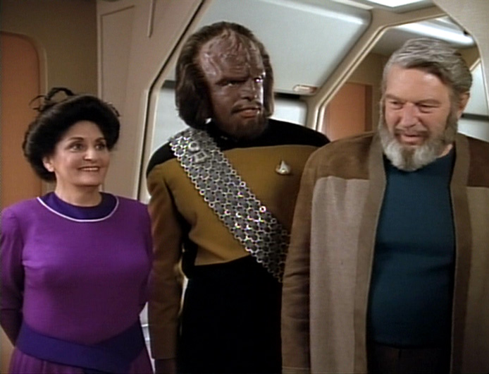 Worf with his adopted parents, the Rozhenkos.